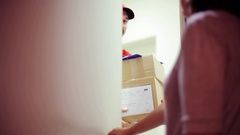 Man delivering parcel boxes to wrong customer Stock Footage