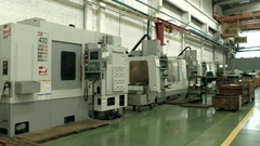Footage of a factory manufacturing automobile parts Stock Footage
