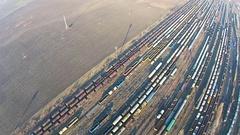 Aerial flight over industrial train depot Stock Footage