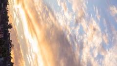 Timelapse of Sunset Afterglow Illuminating Autumn Sky -Vertical- Stock Footage