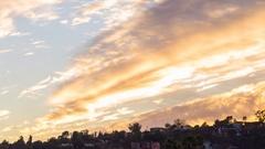Timelapse of Sunset Afterglow Illuminating Autumn Sky -Long Crop- Stock Footage
