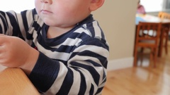 A dolly shot of a toddler playing with legos on the counter Stock Footage