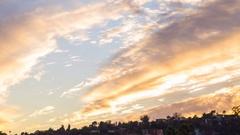 Timelapse of Sunset Afterglow Illuminating Autumn Sky -Pan Left- Stock Footage