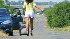 4K. Hot summer and hot woman. Sexy  woman  ask help on  road. Hitchhiking  Stock Footage