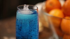 A glass of blue cold drink, floating polar bear-shaped ice Stock Footage