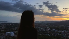 Young beautiful Woman making Sunset photo with Mobile Phone and smiling at Stock Footage