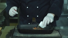 Bottle pours liquid onto pan. Meat and green vegetable. Fried beef and asparagus Stock Footage