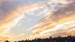 Timelapse of Sunset Afterglow Illuminating Autumn Sky -Tilt Up- Stock Footage