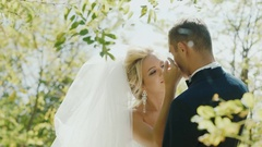 Romantic wedding couple bathing in the sun. They look at each other Stock Footage