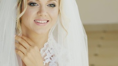 Portrait of a young blond Caucasian bride. Smiling, looking at the camera Stock Footage