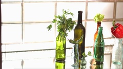 Parsley and peppers on a variety of glass bottles Stock Footage