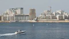 Boat ,Yacht sails in the background of city Valletta in Malta. Wide shot, in the Stock Footage