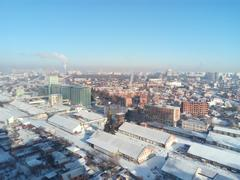 Winter town. Frosty sunny day in the city. Snow on the streets and smoke fr.. Kuvituskuvat