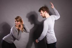 Aggressive man yelling on woman. Stock Photos