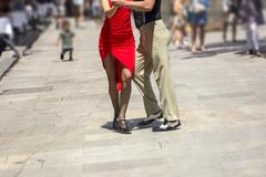 Street dancers performing tango in the street among the people Kuvituskuvat