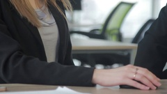 Business people shaking hands over a Desk. Office workers in business clothes Stock Footage