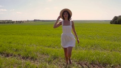 Young girl in white dress and straw hat Stock Footage