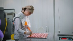 Kind of a young confectioner woman who is standing sideways in the confectionery Stock Footage