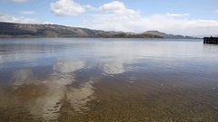 Loch Lomond Scotland UK in summer with mountains and jetty pan Stock Footage