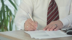 Businessman in white shirt signs an important document. In the frame document Stock Footage
