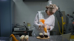 Confectionary. Chef decorates an order for a holiday. Woman made chocolate cakes Stock Footage