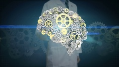 Researcher, Engineer touching Steel golden gears making human brain shape. Stock Footage