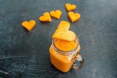 Papaya cutting shape of the heart.  smoothies. The flat lying structure. lo.. Stock Photos