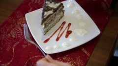 Close-up man's hands cut the cake. Cutting Serving and Eating Sequence Stock Footage