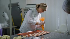 Some pastry chefs at work in a candy shop. One of the women involved in the Stock Footage