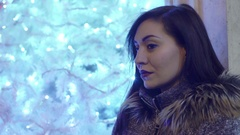 Sexy thoughtful woman at Christmas Stock Footage