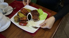 Close-up man's hands cut the grill meat. Cutting Serving and Eating Sequence Stock Footage