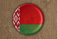 Belarus Textured Round Flag wood on rough cloth Stock Photos