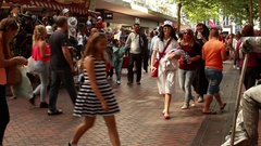 Zombie walking public street among ordinary people shopping. Zombie midwife Stock Footage