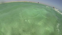 A woman kite surfing on the Red Sea in Egypt, slow motion. Stock Footage