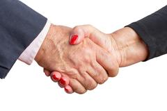 Close up view of an elderly couple shaking hands Stock Photos