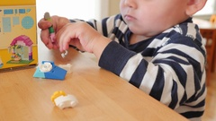 Dolly shot of a toddler playing with legos on the counter Stock Footage