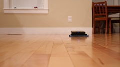 Robot mop cleans the floor inside home Stock Footage