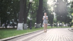 The girl had pain during running in green park Stock Footage
