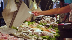VENICE, ITALY - JUNE 20, 2016: Buying of fresh seafood and fish at a market Stock Footage