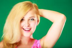 Happy smiling blonde woman in pink top Stock Photos