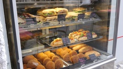 Valletta, Malta - fast food street point with sandwiches layout behind glass Stock Footage