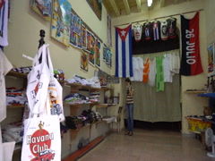 Panoramic view to an interior of the souvenir store in Havana Stock Footage