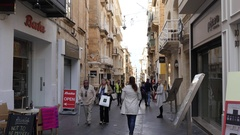 Valletta, Malta - beautiful streets and buildings and people tourists walk Stock Footage