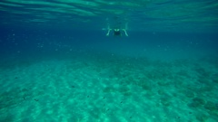 A woman swims undersea in sunny day in Aegean sea in Greece Stock Footage