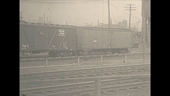 Vintage 16mm film, 1930 Railroad, Boston and Maine humping cars in yard Stock Footage