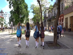Local school girls in blue uniform walk during break between lessons at H Stock Footage