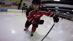 Hockey trick shot one timer to self off skate scores Stock Footage