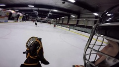 Hockey goalie helmet cam glove save on slapshot Stock Footage