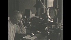 Vintage 16mm film, 1930 Railroad, Boston and Maine Station master at desk, phone Stock Footage
