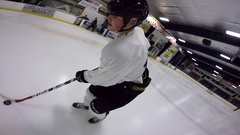 Hockey player amazing spinning trick shot to scoop puck up and score big celly Stock Footage